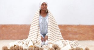 Handwoven Moroccan Bedding with Pom Poms, hand woven by artisans on traditional wooden looms. BW3