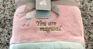 Pink Unicorn Blanket NWT. This cute pink fuzzy blanket has a small unicorn in th...