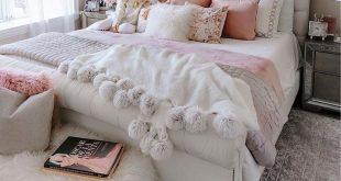 Sew fur Pom poms on 2 opposite sides of fuzzy blanket.