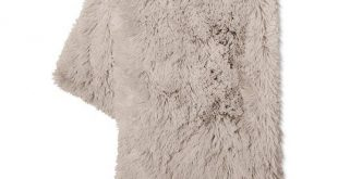 Come home after a long day and cozy up with this Gray Long Faux Fur Throw from X...